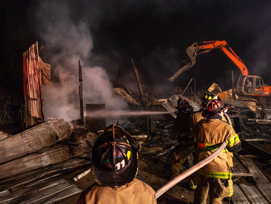 Firefighters work at the scene of a fully-involved