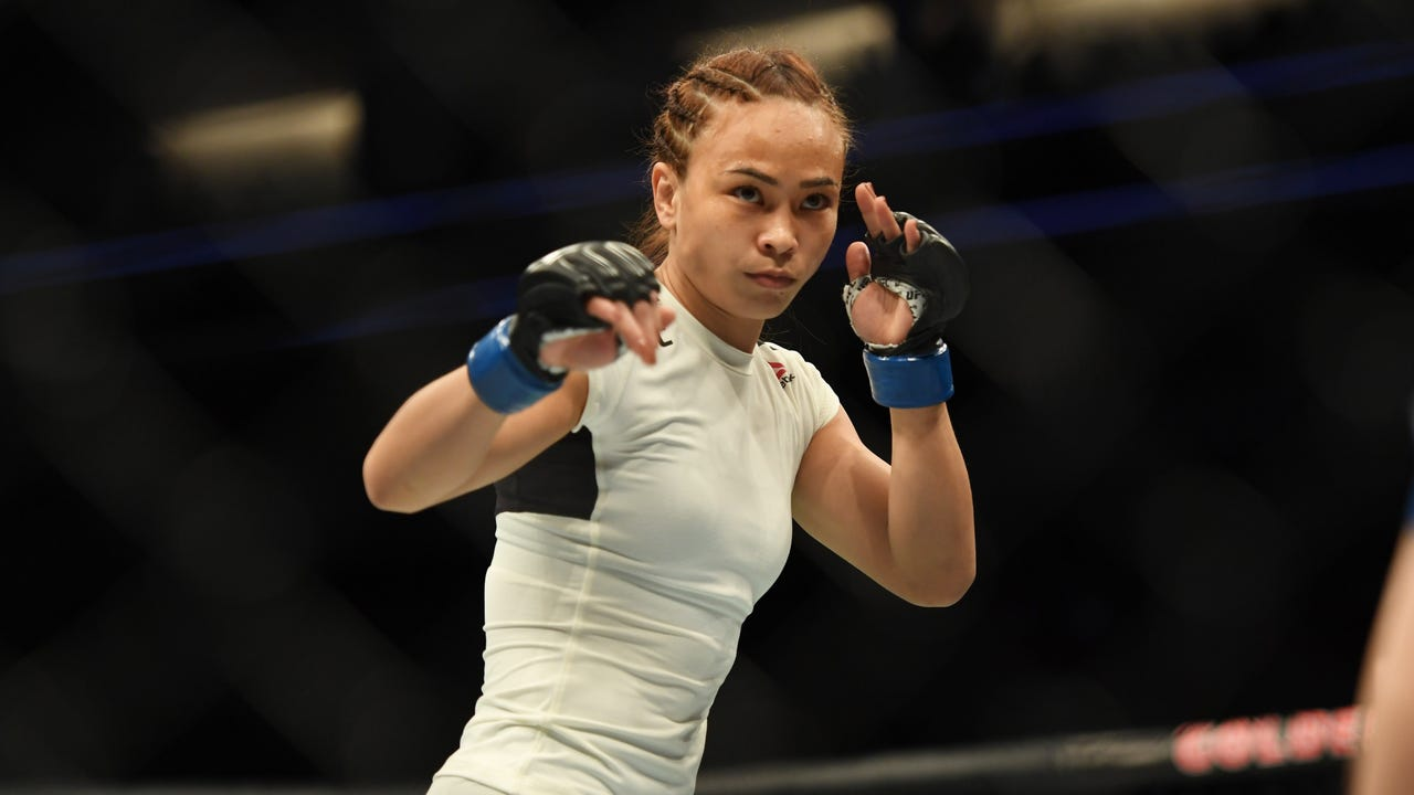 UFC strawweight Michelle Waterson has no problem bringing her 6-year-old daughter to her fights and isn't bothered by another who feels differently.