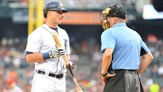 Tigers' James McCann talks with home plate umpire Mike Everitt after a called third strike in the second inning.