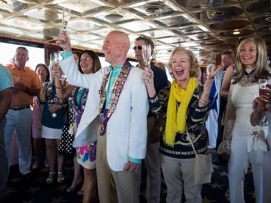 Members from the Naples chapter of Chaine des Rotisseurs-International Association of Gastronomy cheer as they find out that they are at Lacey King and Alan Goodridge's surprise wedding held on the Naples Princess on Saturday, April 21, 2018.