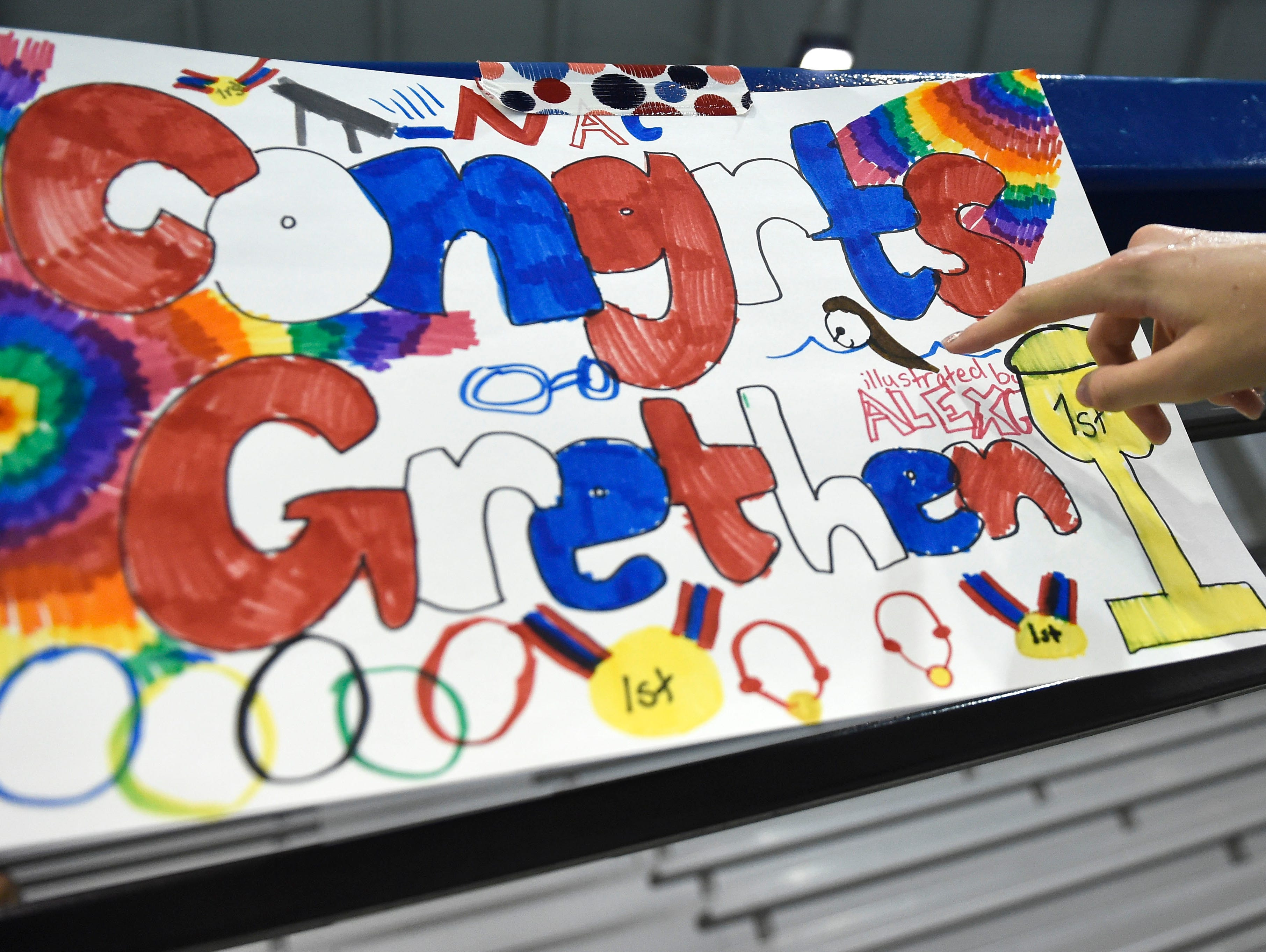 Younger swimmers show their support for Gretchen Walsh, who qualified for the Olympic Trials.