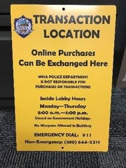 A Mesa police station sign for a safe transaction location.