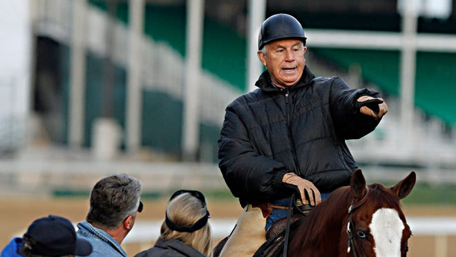 Hall of Fame trainer D. Wayne Lukas oversees training on the Churchill backside last year.