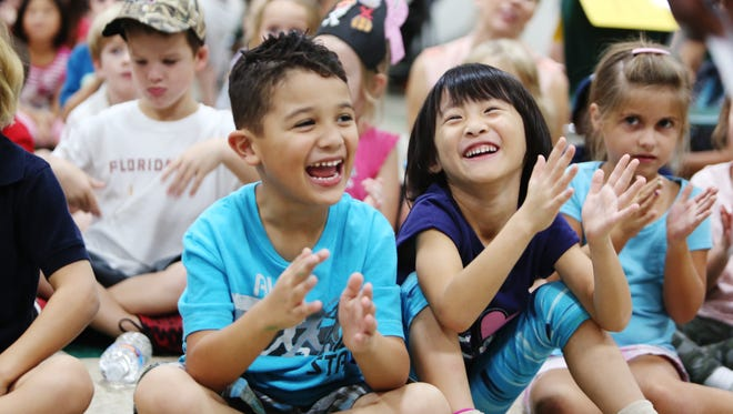 Hawksrise Elementary School was named as a National Blue Ribbon school. Kindergartners Elijah Garris, left, Emily Ding and other students cheer and clap when the award is announced during a pep rally on Tuesday.