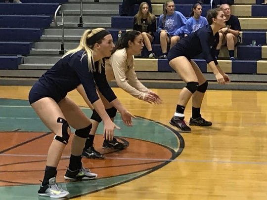The Indian Hills back row of (from left) Madeline Paterson, Emma Kimura and Rachael Butler set up for a serve-receive versus Midland Park in an Oct. 14, 2017 Bergen County girls volleyball tournament match.