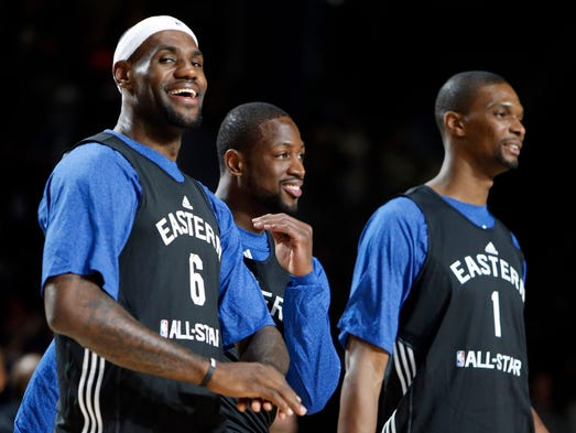 Miami Heat's Big Three headline the Eastern Conference All-Star team. Flip through to see others on the roster.