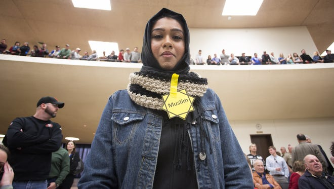 Rabya Ahmed listens as Republican presidential candidate Donald Trump makes a speech at a campaign rally March 5, 2016, in Wichita.