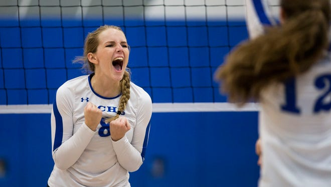 Julie Tanner, #8, screams with excitement after scoring a point in the Class 7A Regional Championship volleyball game at Barron Collier High School on Tuesday, Nov. 1, 2016 in Naples, Florida. Barron Collier defeated Charlotte 3-0 to secure the championship win.