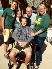 Sten Kordon (front) is pictured with his brother Jon Kordon (left), grandmother Audrey Grasse, father Peter Kordon and mother Kristine Kordon on Sept. 18 at St. Vincent Hospital in Green Bay.