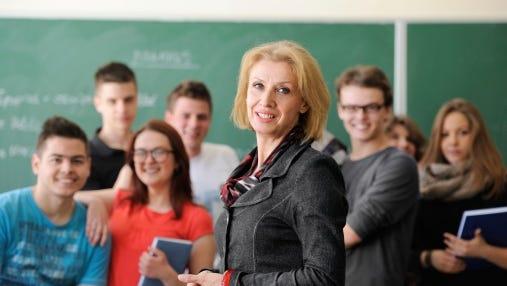 Teacher smiling in her classroom.
