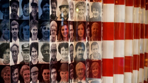 Montage of images of immigrants in the United States on a flag in the Immigration Museum on Ellis Island.