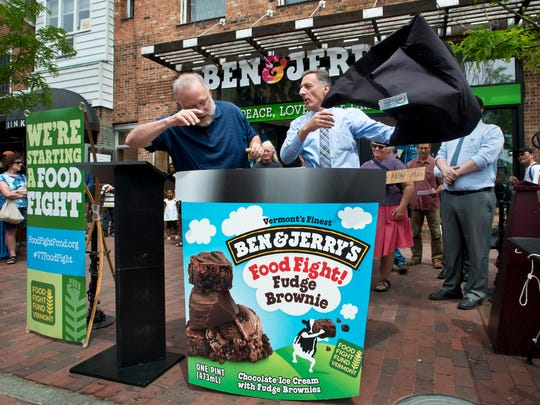 Jerry Greenfield, co-founder of Ben & Jerry's ice cream, left, and Gov. Peter Shumlin announce at a rally in Burlington on June 16 that Ben & Jerry's will rename one of its ice creams and donate $1 from each pint sold to the Food Fight Fund. The fund is to help defray the cost of defending the state's new GMO-labeling law against lawsuits alleging the measure is unconstitutional.