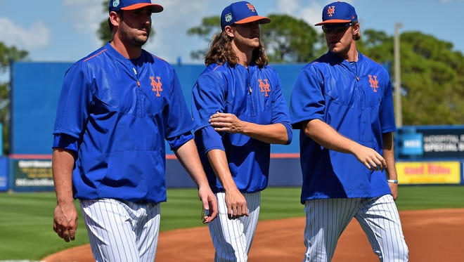 The Mets would love to get through a full season with starting pitchers (L-R) Matt Harvey, Jacob deGrom and Noah Syndergaard all healthy.