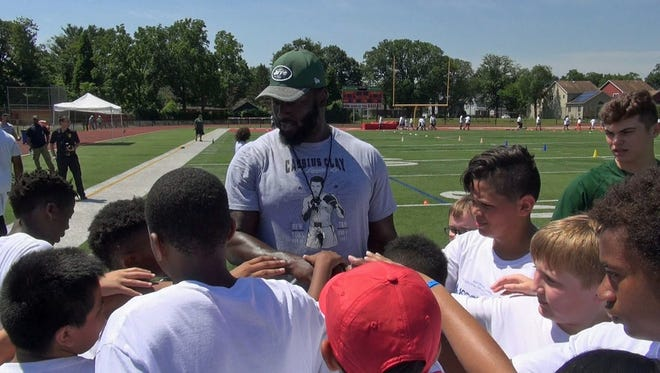 "Former Jets football player Mo Wilkerson of Linden participated in the 2017 ""Scoop & Score"" football camp in Edison."