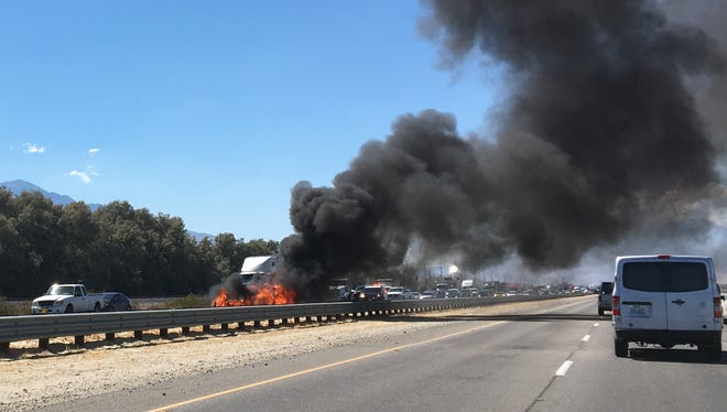A car fire slowed traffic on Interstate 10 at Cook Street Thursday afternoon.