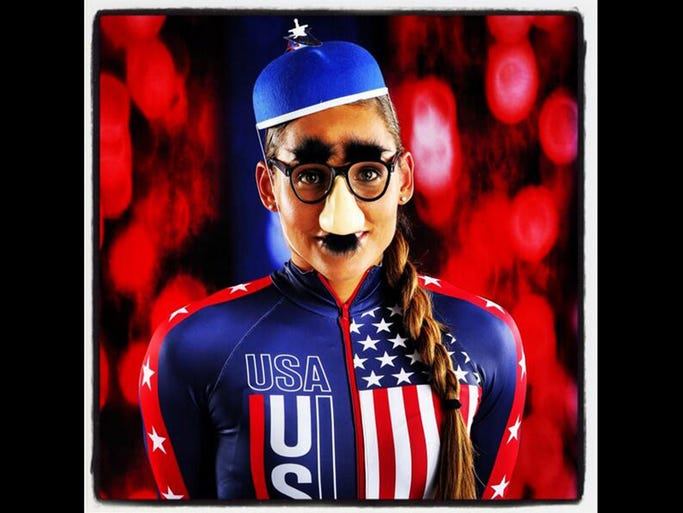 Team USA bobsled hopeful Lolo Jones poses for a fun photo with props at the Team USA Media Summit in Park City, Utah.