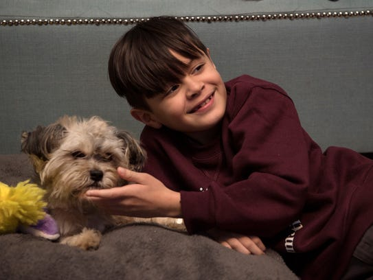 Jacob Rodriguez, 7, with his dog, Brownie, on Wednesday,