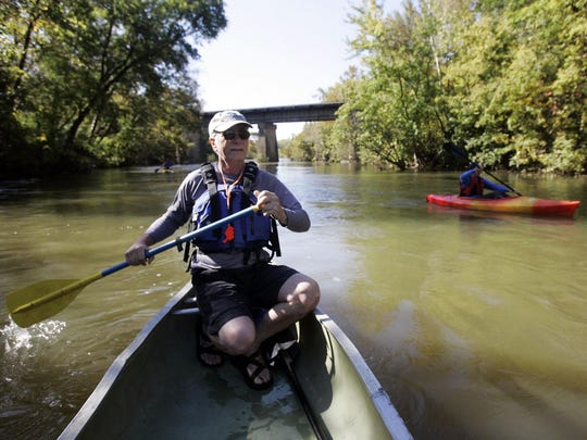 Randal Branch of the Stones River watershed Association paddles his canoe near the Manson Pike Trailhead on the Stones River in this 2015 file photo.