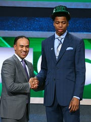 Deyonta Davis shakes hands with NBA Deputy Commissioner