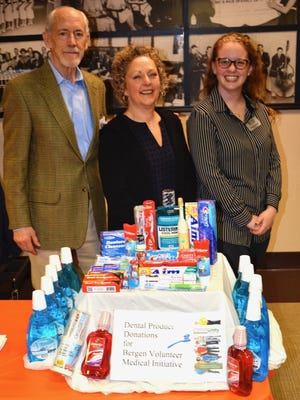 Dental supplies collected for the Bergen Volunteer Medical Initiative.  From left: Michael Shannon, president of the Northern New Jersey Community Foundation; Amanda Missey, executive director of BVMI; and Samantha Poremba, development coordinator at BVMI.
