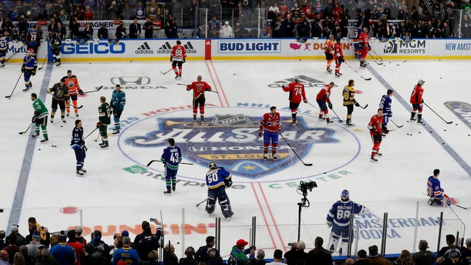 Players warm up before the Skills Competition, part of the NHL All-Star weekend, Friday, Jan. 24, 2020, in St. Louis.