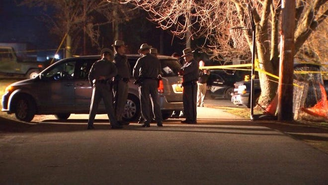 Police investigate after a mentally ill man with a knife was fatally shot by police in Port Jervis on March 19.
