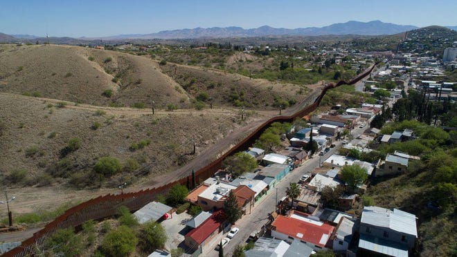 This April 2, 2017, file photo made with a drone, shows the U.S. Mexico border fence as it cuts through the two downtowns of Nogales.