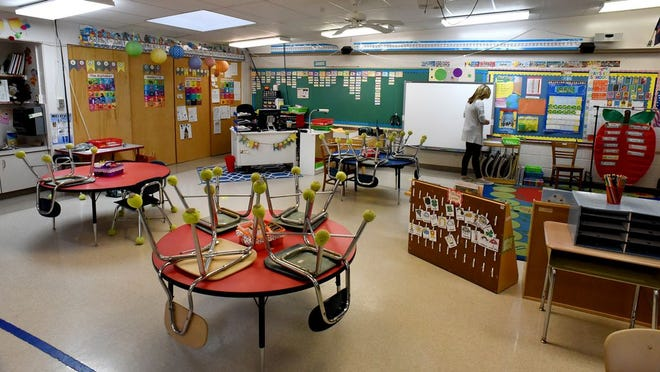 Summerfield Elementary School kindergarten teacher Wendy Myers cleans up her classroom in May. For the first time in nearly six months, students will return to school Sept. 8. Districts have shared ways families can support their safe reopening amid COVID-19.