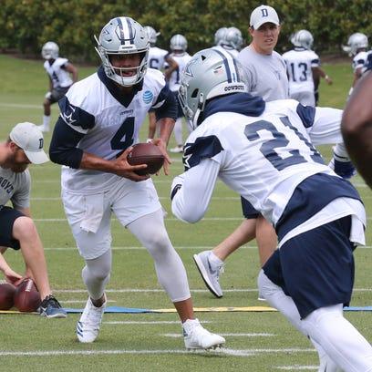 Dallas Cowboys quarterback Dak Prescott (4) hands off