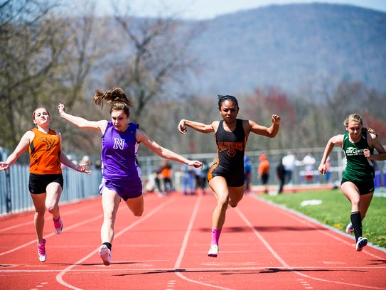 Central York's Haven Evans crosses the finish line