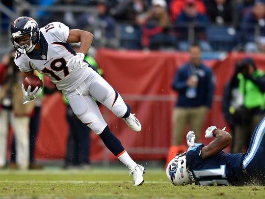 Broncos wide receiver Kalif Raymond (19) makes a catch at Nissan Stadium Sunday, Dec. 11, 2016, in Nashville, Tenn.
