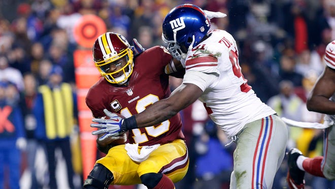 Justin Tuck, right, brings down Robert Griffin III for one of his four sacks.