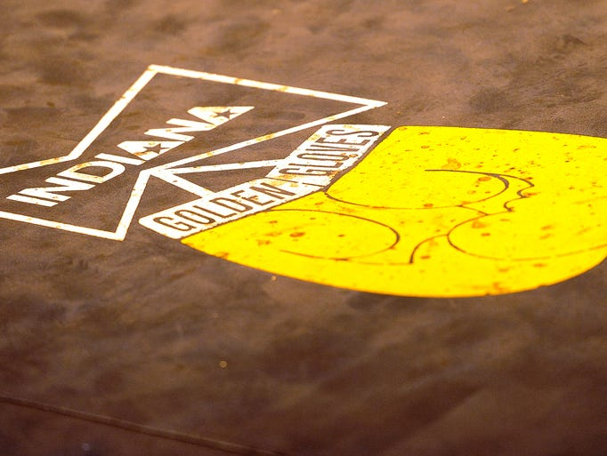 Blood stains the logo for the Indiana Golden Gloves during the finals inside the Tyndall Armory, Thursday, April 17, 2014, in Indianapolis.
