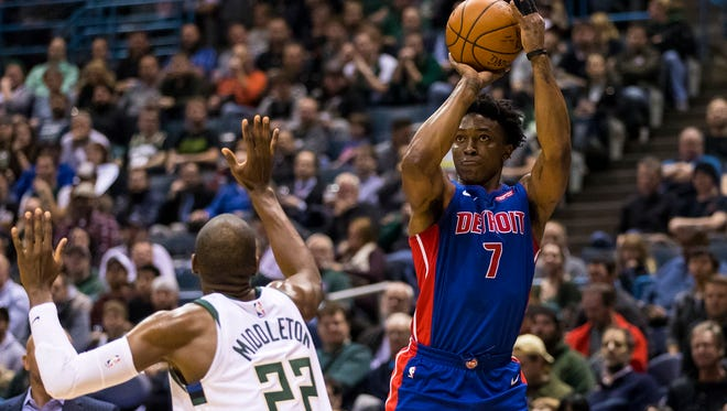 Detroit Pistons forward Stanley Johnson (7) shoots over Milwaukee Bucks forward Khris Middleton (22) during the third quarter at BMO Harris Bradley Center.