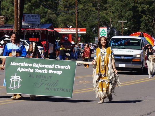 Mescalero Reformed Church Apache Youth Group at the AspenFest parade Saturday in Ruidoso.