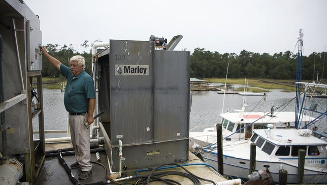 Rutledge Leland, McClellanville's mayor of 40 years, turns off an ice machine at one of the town's fishing docks Friday afternoon Oct. 7, 2016 as he and the rest of the small Charleston County community prepare for Hurricane Matthew. Today Mayor Leland moved 10,000 pounds of frozen shrimp from the dock to a frozen truck in Georgetown.