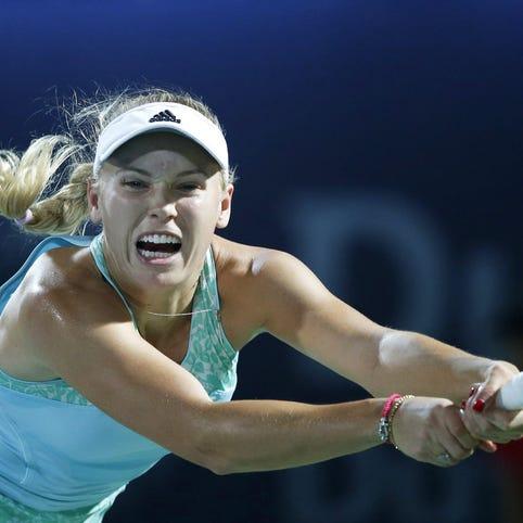 In a photo from Dubai in February, Caroline Wozniacki of Denmark returns the ball during the semifinal match of Dubai Duty Free Tennis WTA Championships.