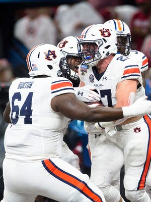 Auburn fullback Chandler Cox (27) celebrates with Auburn offensive lineman Mike Horton (64) after scoring a touchdown during the Sugar Bowl between Auburn and Oklahoma on Monday, Jan. 2, 2017, at the Super Dome in New Orleans, La.