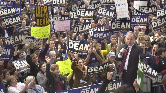 In 2004, presidental candidate Howard Dean holds a rally in a bandshell at Reid Park in Tucson, Arizona, attended by about 2,500 supporters.