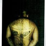 Angel Servina, a confirmed gang member, is photographed during an assault arrest in 2011.