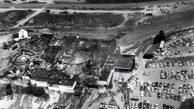 The day after the Beverly Hills Supper Club fire reveals unclaimed cars and a collapsed roof Sunday, May 29, 1977.