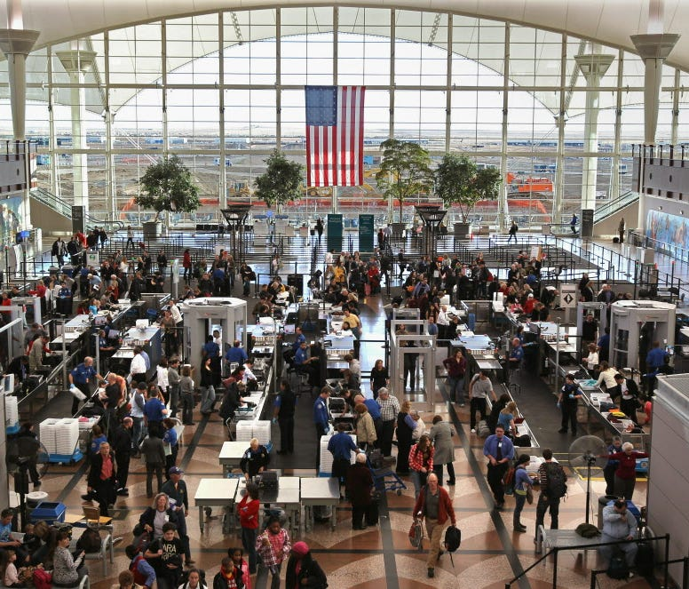Passengers move through a main security checkpoint at the Denver International Airport on Nov. 22, 2010 in Denver, Colo.