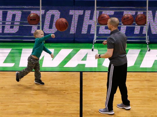 Mar 15, 2017; Milwaukee, WI, USA; Winthrop basketball coach Pat Kelsey (right) plays around with his four-year-old son Johnny during practice for the first round of the NCAA Division I Men's Basketball Championship at the BMO Harris Bradley Center. Mandatory Credit: Mark Hoffman/Milwaukee Journal Sentinel via USA TODAY NETWORK
