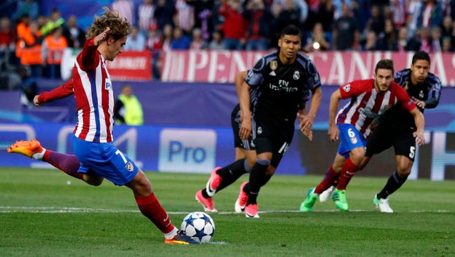 Atletico Madrid's Antoine Griezmann scores a penalty during a Champions League semifinal match against Real Madrid.