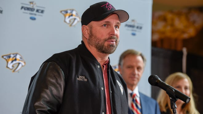 Garth Brooks thanks Governor Bill Haslam and Mayor Megan Barry for the banner that was presented to him for all of his support during the 2010 floods in Nashville at the Bridgestone Arena in Nashville, Tenn., Wednesday, Nov. 1, 2017.