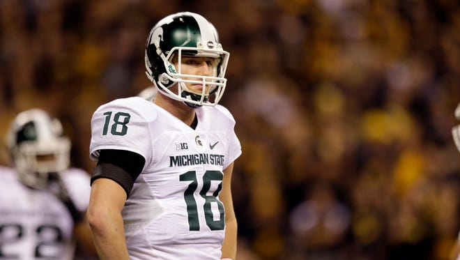 Michigan State quarterback Connor Cook looks to the sideline against Iowa on Dec. 5, 2015, in Indianapolis.