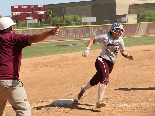 Jenna Murphy rounds third to score for Rancho Mirage in their game against Mary Star, May 24, 2018.