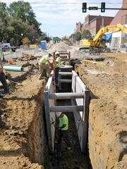 Garney Construction workers prepare a 10-foot trench for a new sewer pipe along First Street in September 2010. The downtown sewer and water line revamp was part of a larger, 10-year, $41 million project.