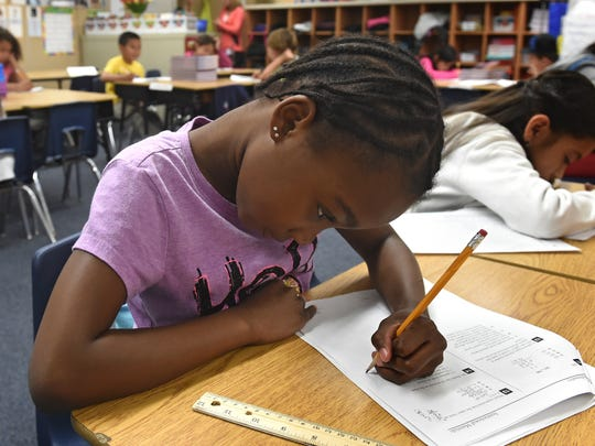 Aria Anderson and the rest of her third-grade class study for a test at Libby Booth Elementary on April 16.