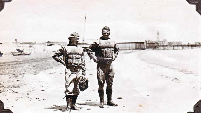 """Lt. Cmdr. Henry C. Mustin, right, stands near the Navy Yard at NAS Pensacola with a photographer in the mid-1910s. Mustin was the first commanding officer of the base, and is widely credited as the """"Father of Naval Aviation."""""""